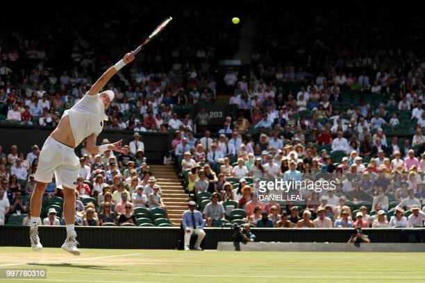 South Africa's Kevin Anderson serves against US player John Isner during their men's singles semifinal match on the eleventh day of the 2018...
