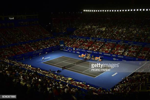 South Africas Kevin Anderson serves to South Korea's Hyeon Chung during their Mexico ATP 500 Open men's single tennis match in Acapulco, Guerrero...
