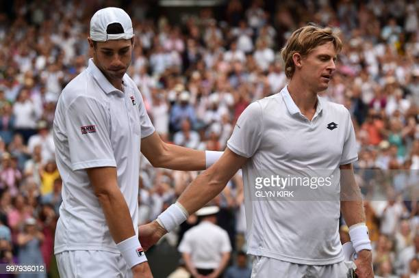 TOPSHOT South Africa's Kevin Anderson shakes hands after winning against US player John Isner during the final set tiebreak of their men's singles...