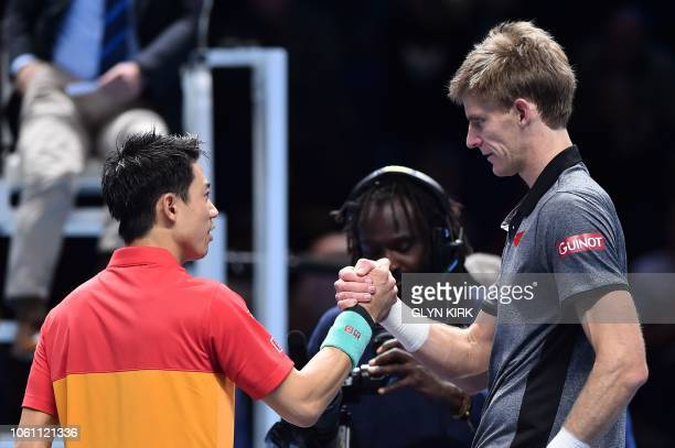 South Africa's Kevin Anderson shakes hands with Japan's Kei Nishikori after Anderson won their men's singles roundrobin match on day three of the ATP...