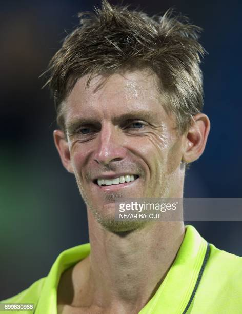 South Africas Kevin Anderson smiles after winning the Mubadala World Tennis Championship 2017 match in Abu Dhabi on December 30 2017 / AFP PHOTO /...