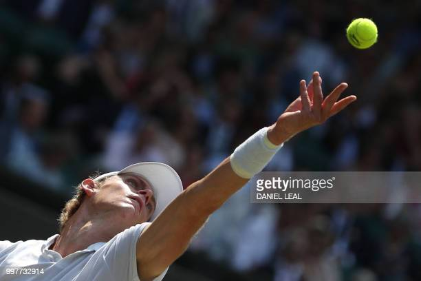 TOPSHOT South Africa's Kevin Anderson throws the ball to serve against US player John Isner during their men's singles semifinal match on the...
