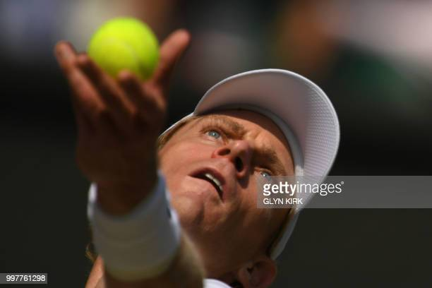 South Africa's Kevin Anderson throws the ball to serve against US player John Isner during their men's singles semifinal match on the eleventh day of...