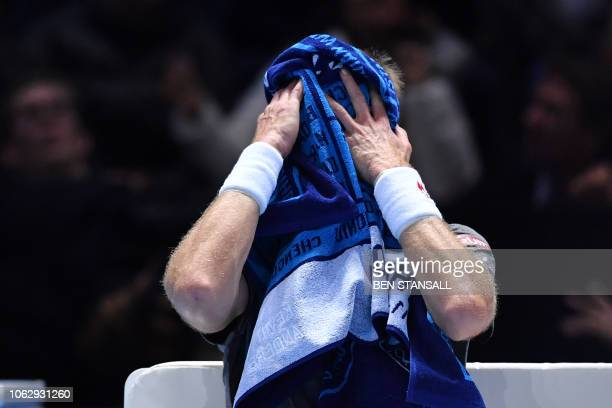 South Africa's Kevin Anderson uses a towel during a break between games against Serbia's Novak Djokovic during their men's singles semifinal match on...