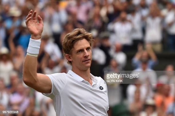 South Africa's Kevin Anderson waves to the crowd after winning against US player John Isner during the final set tiebreak of their men's singles...