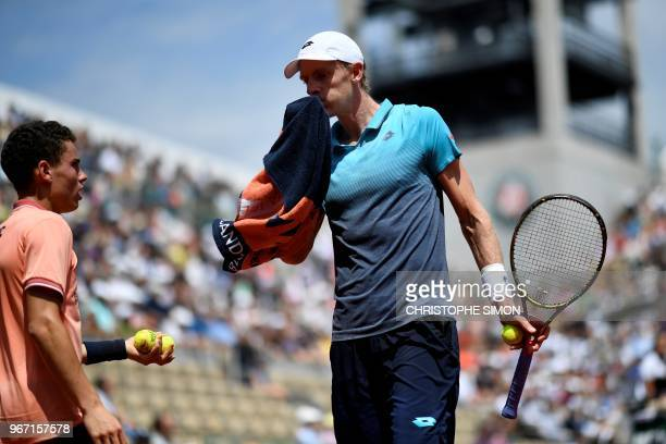 South Africa's Kevin Anderson wipes his face with a towel between points against Argentina's Diego Schwartzman during their men's singles fourth...