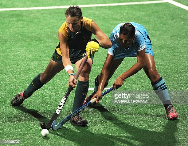 South Africa's Kim Hubach fights for the ball with India's Rani Rampal during their field hockey match at the Major Dhyan Chand National Stadium...