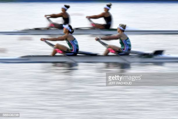 South Africa's Kirsten McCann and South Africa's Ursula Grobler compete with New Zealand's Julia Edward and New Zealand's Sophie Mackenzie during the...