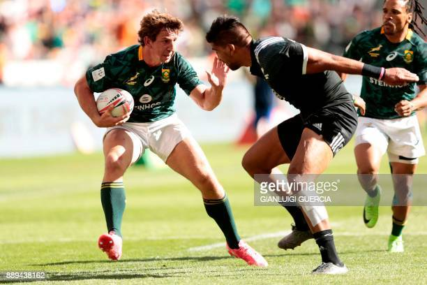 South Africa's Kwagga Smith is tackled by New Zealand's Dylan Collier during their semifinal match on the second day of the World Rugby Sevens Series...