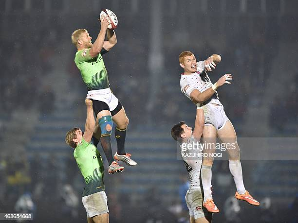 South Africa's Kyle Brown and England's James Rodwell fight for the ball during their final match at the Tokyo Rugby Sevens in Tokyo on April 5,...