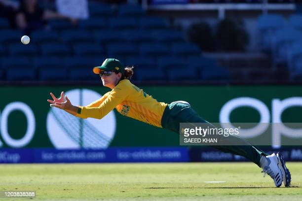 South Africa's Laura Wolvaardt dives to a successful catch to dismiss Thailand's Sornnarin Tippoch during the Twenty20 women's World Cup cricket...
