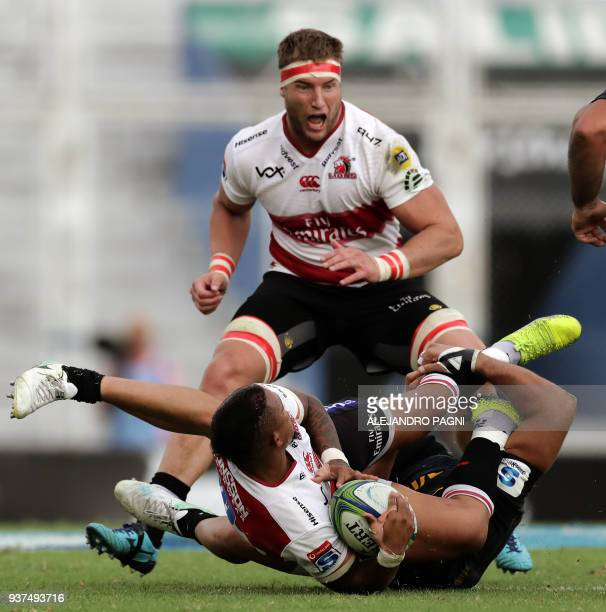 South Africa's Lions fly half Elton Jantjies is tackled by Argentina's Jaguares N8 Javier Ortega Desio during their Super Rugby match at Jose...