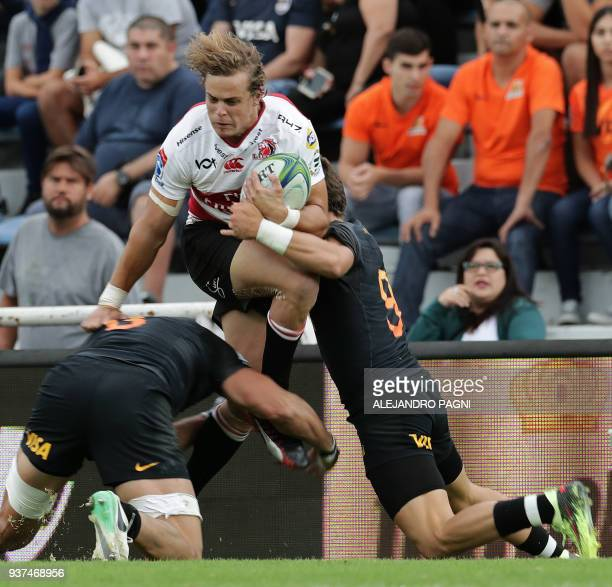 South Africa's Lions fullback Malcolm Marx vies for the ball between Argentina's Jaguares N8 Javier Ortega Desio and half scrum Gonzalo Bertranou...