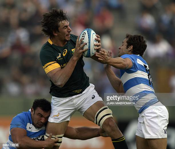 South Africa's lock Eben Etzebeth is tackled by Argentina's Los Pumas hooker Agustin Creevy and flyhalf Nicolas Sanchez during their Rugby...
