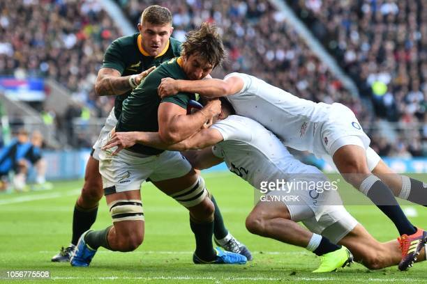 South Africa's lock Eben Etzebeth is tackled short of the try line during the international rugby union test match between England and South Africa...
