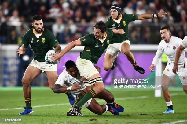 South Africa's lock Eben Etzebeth passes the ball to South Africa's centre Damian De Allende during the Japan 2019 Rugby World Cup final match...