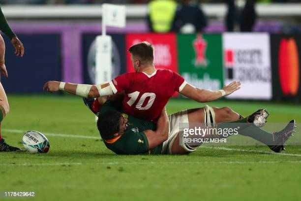 South Africa's lock Eben Etzebeth tackles Wales' flyhalf Dan Biggar during the Japan 2019 Rugby World Cup semifinal match between Wales and South...