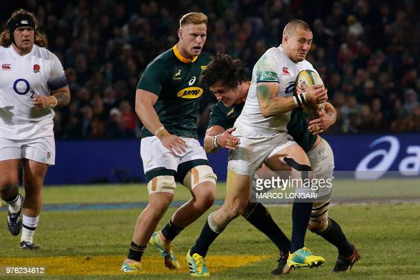 South Africa's lock Franco Mostert tackles England fullback Mike Brown during the second test match South Africa vs England at the Free State Stadium...