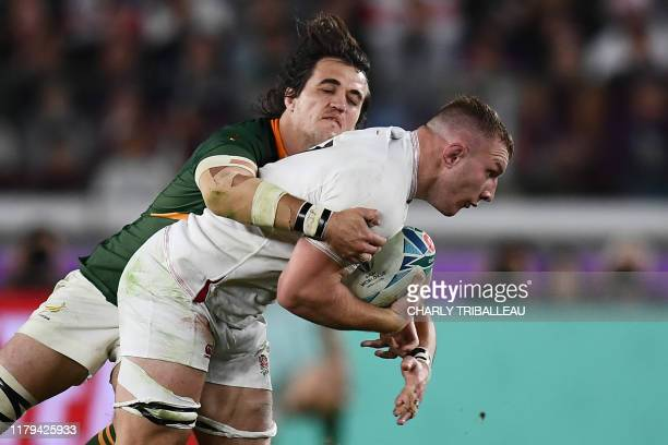 South Africa's lock Franco Mostert tackles England's flanker Sam Underhill during the Japan 2019 Rugby World Cup final match between England and...