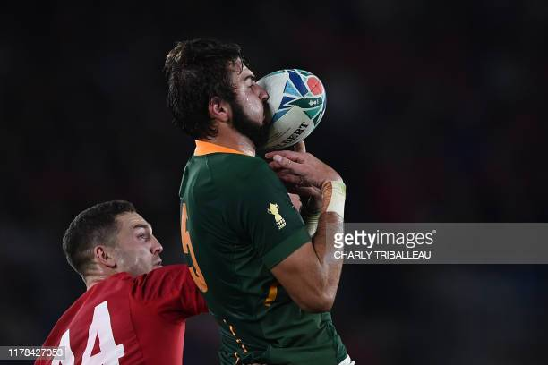 TOPSHOT South Africa's lock Lood De Jager catches the ball beside Wales' wing George North during the Japan 2019 Rugby World Cup semifinal match...