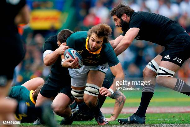 South Africa's lock Lood de Jager is tackled during the Rugby test match between South Africa and New Zealand at Newlands Rugby stadium on October 7...