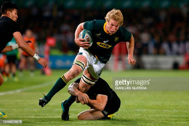 South Africa's lock Pieter-Steph du Toit is takled by New Zealand's left centre Sonny Bill Williams during the Rugby Championship match between South...