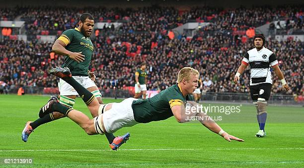 TOPSHOT South Africa's lock PieterSteph du Toit scores their first try during the international rugby union Test match between Barbarians and South...