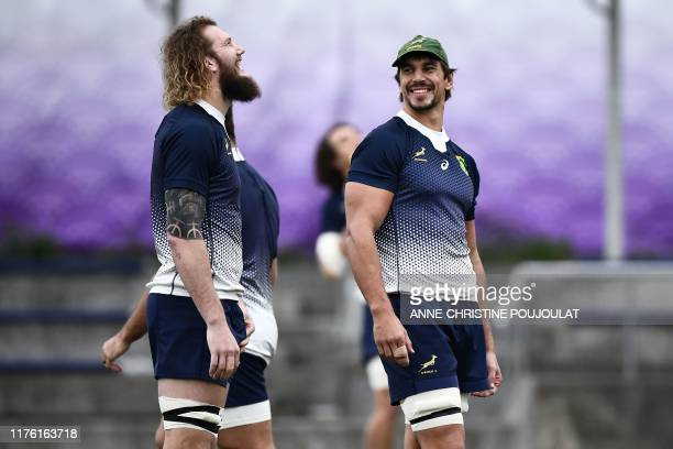 South Africa's lock RG Snyman and lock Eben Etzebeth takes part in a training session at the Fuchu Asahi Football Park in Tokyo on October 16 ahead...