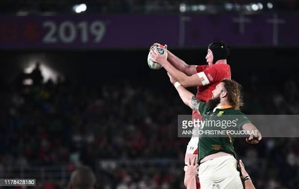 South Africa's lock RG Snyman reaches for the ball past Wales' lock Adam Beard during the Japan 2019 Rugby World Cup semifinal match between Wales...