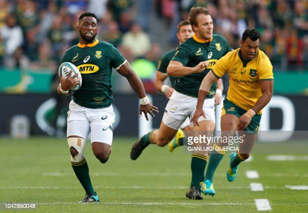 South Africa's loose forward Siya Kolisi runs with the ball during the Rugby Championship match between South Africa and Australia at Nelson Mandela...