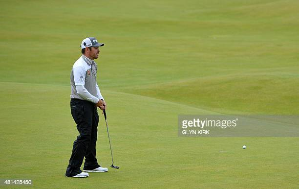 South Africa's Louis Oosthuizen misses his birdie putt on the 18th green to hand victory to Zach Johnson in the playoff on day five of the 2015...