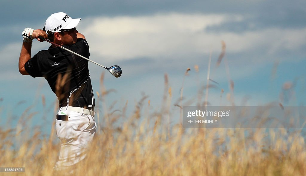 South Africa's Louis Oosthuizen plays the sixth tee during the first round of the 2013 British Open Golf Championship at Muirfield golf course at Gullane in Scotland on July 18, 2013 .