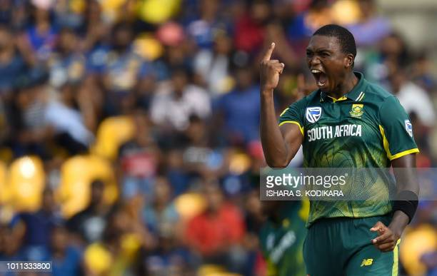 South Africa's Lungi Ngidi celebrates after he dismissed Sri Lankan cricketer Kusal Mendis plays a shot during the third One Day International...