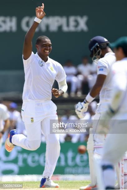 South Africa's Lungi Ngidi celebrates after he dismissed Sri Lanka's Dimuth Karunaratne during the third day of their second Test match between Sri...
