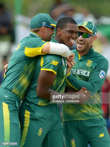 South Africa's Lungi Ngidi celebrates with captain Faf du Plessis and teammate Aiden Markram celebrate after he dismissed Sri Lanka's Kusal Mendis...