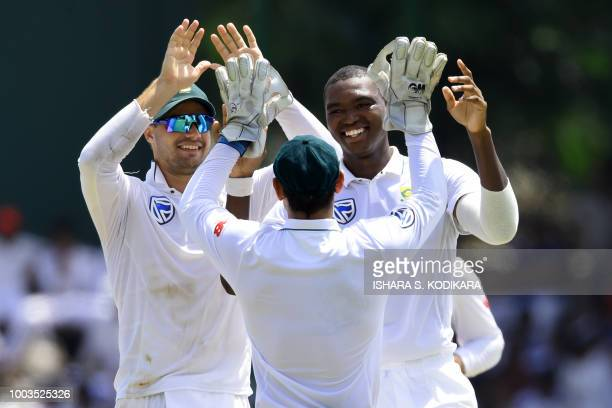South Africa's Lungi Ngidi celebrates with his teammates after he dismissed Sri Lanka's Dimuth Karunaratne during the third day of their second Test...