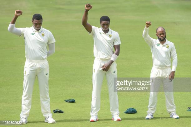 South Africa's Lungi Ngidi , South Africa's Lutho Sipamla , and South Africa's Temba Bavuma raise their fists in solidarity with the Black Lives...