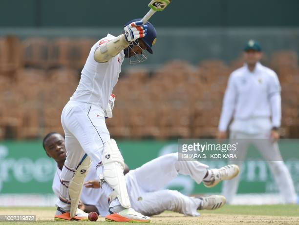 South Africa's Lungi Ngidi stops a ball beside Sri Lanka's Danushka Gunathilaka during the first day of the second and final Test match between Sri...