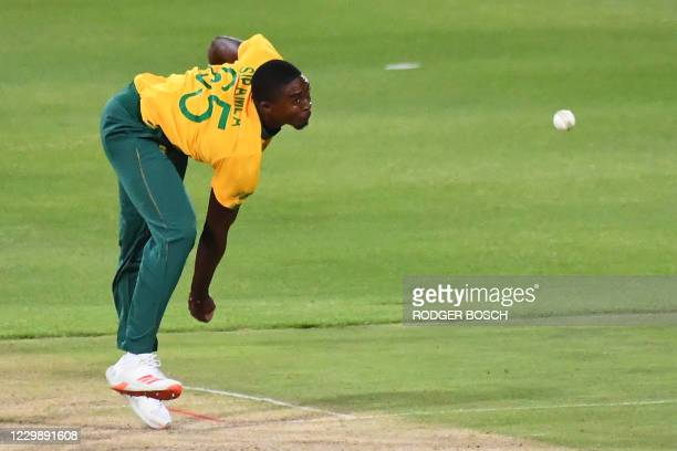 South Africa's Lutho Sipamla delivers a ball during the third T20 international cricket match between South Africa and England at Newlands stadium in...