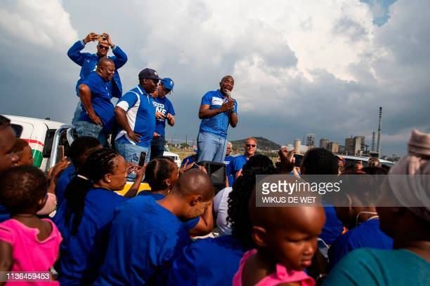 South Africa's main opposition Democratic Alliance leader Mmusi Maimane speaks at a small gathering of Marikana community members as part his...