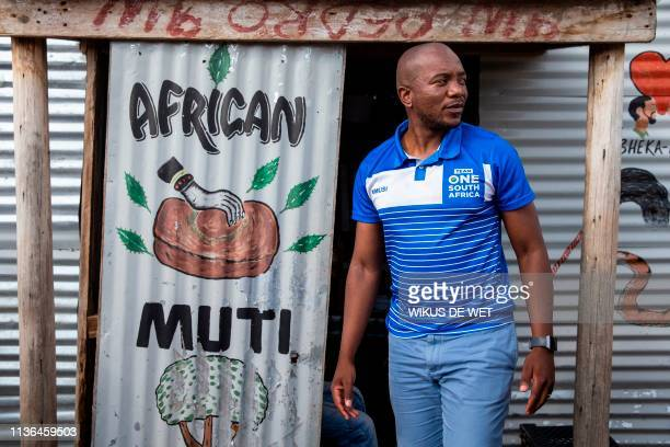 South Africa's main opposition Democratic Alliance leader Mmusi Maimane walks in the Marikana community as part his election campaign trail ahead of...