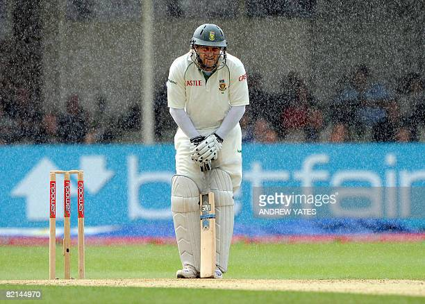 South Africa's Mark Boucher stands in the rain during the third day of the third test cricket match against England at Edgbaston, Birmingham, central...