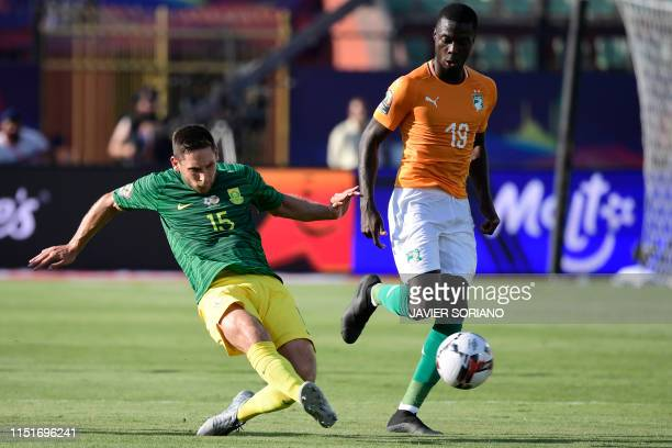 South Africa's midfielder Dean Furman fights for the ball with Ivory Coast's forward Nicolas Pepe during the 2019 Africa Cup of Nations football...