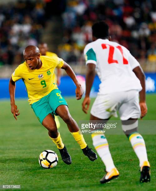 South Africa's midfielder Lebogang Manyama vies for the ball Senegal's defender Lamine Gassama during the FIFA 2018 World Cup Africa Group D...