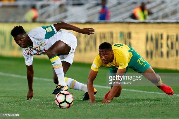 South Africa's midfielder Sibusiso Vilakazi vies for the ball with Senegal's defender Lamine Gassama during the FIFA 2018 World Cup Africa Group D...
