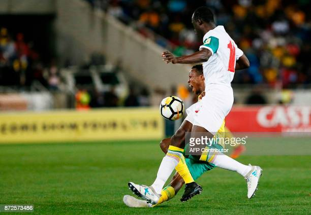 South Africa's midfielder Themba Zwane is tackled by Senegal's midfielder Cheikh Ndoye during the FIFA 2018 World Cup Africa Group D qualifying...