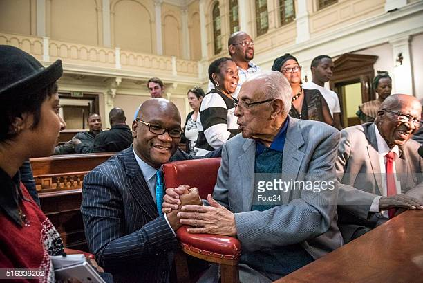 South Africa's minister of Arts and Culture Nathi Mthethwa shakes hands with one of the defendants from the Rivonia Trial Ahmed Kathrada during the...