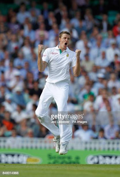 South Africa's Morne Morkel celebrates taking the wicket of England's Jonathan Trott for 71 during the Investec first test match at the Kia Oval...