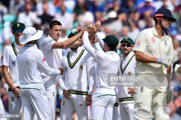 South Africa's Morne Morkel celebrates with teammates the wicket of England's Alastair Cook for 88 on the second day of the third Test match between...