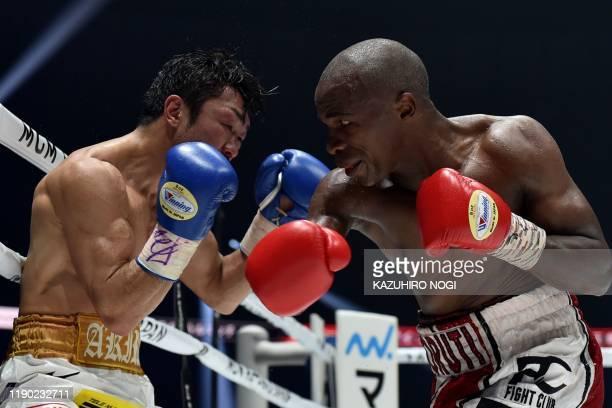 South Africa's Moruti Mthalane and Japan's Akira Yaegashi fight during their IBF flyweight title boxing match at Yokohama Arena in Yokohama, Kanagawa...